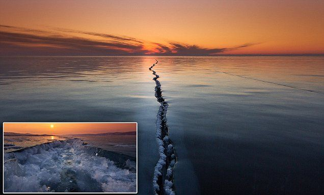 That's a cracking picture: Photographer captures incredible splits hundreds of yards long in the ice of world's largest freshwater lake