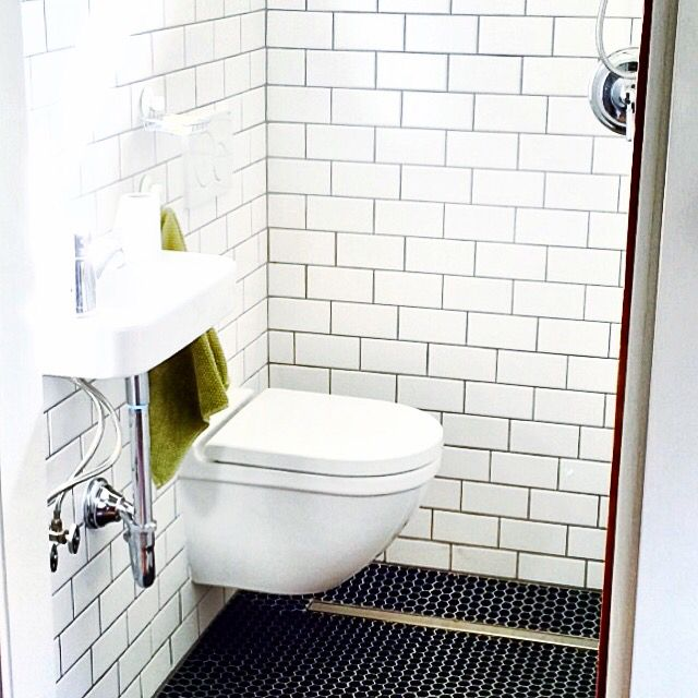 Web Image Gallery Tiny bathroom wall hung toilet and sink subway tile strip drain