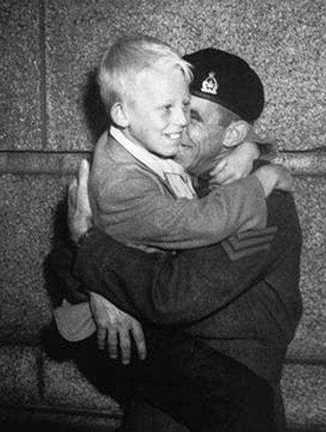 "Warren Bernard of New Westminster, British Columbia was reunited with his father Jack Bernard when he returned from the war. The two were the subject of an iconic photograph called ""Wait For Me, Daddy,"" taken by Province newspaper photographer Claude Dettloff."