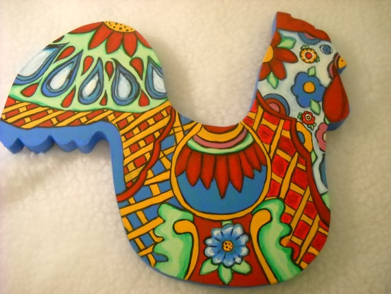 "handpainted wooden chicken, painted in the Talavera pottery style. This piece measures 11"" from tail feathers to beak and 9.5"" from comb to bottom of the piece. It is full of tons of stylized design, all original based on my study of Talavera pottery design, which I admire greatly. I have used lots of brights colors to brighten a dining area or kitchen. This would go well in a French Country kitchen also. This is done in acrylic paint, varnished, with hanger on back for display."