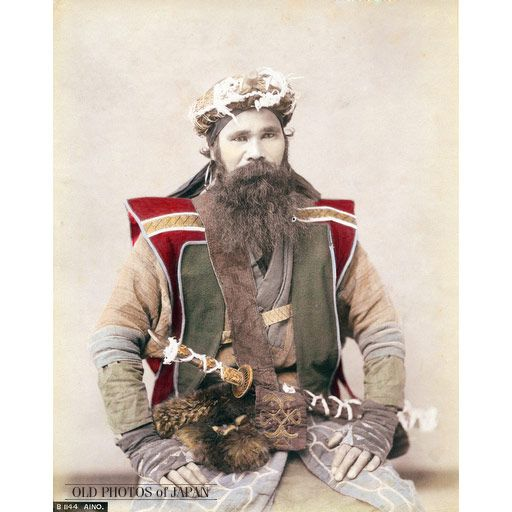 1880's.  A beautiful hand-tinted portrait dating back to the late 19th century of an Ainu man in traditional clothing. He is wearing a sword in a shoulder belt and a ceremonial crown (サパウンペ, Sapaunpe) used during the iomante ritual and other religious rituals.