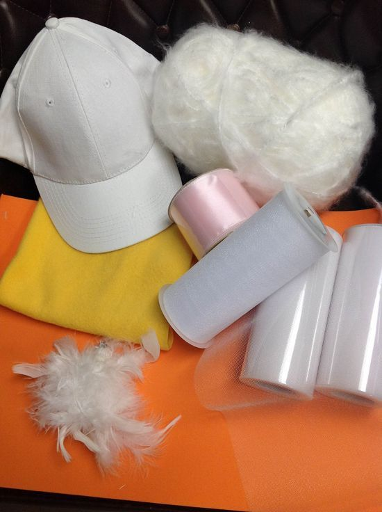 """Daisy Duck- Start with a white hat, some fabric for the bill, sheet foam for the feet, at least 3 rolls 6"""" tulle and maybe a feather clip. You will also need a pair of orange or yellow tights."""