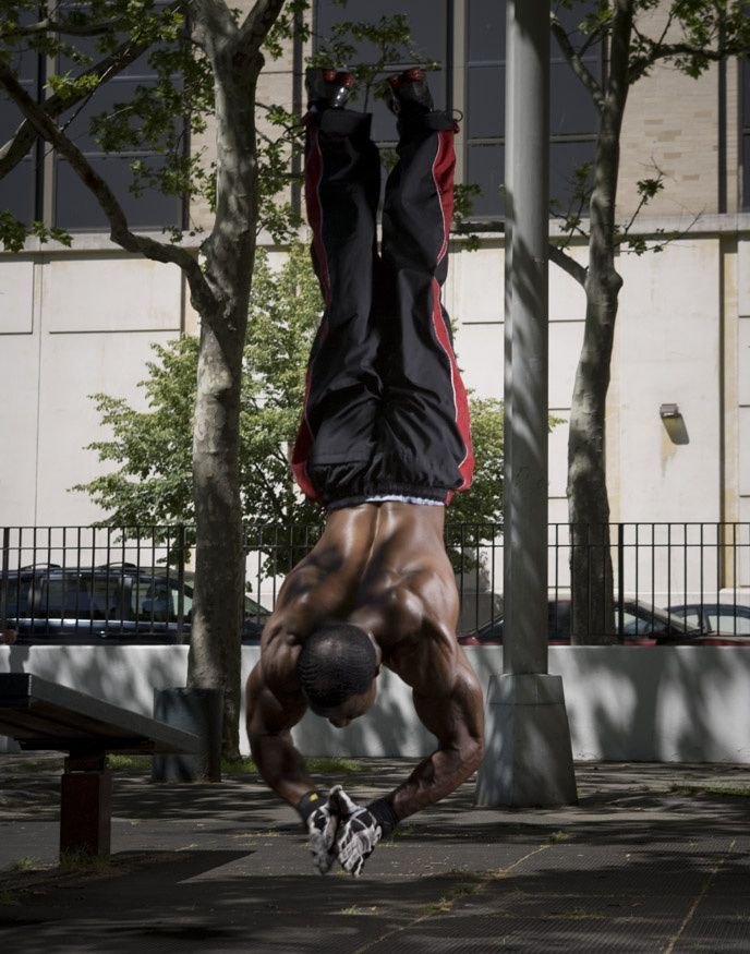 Clapping handstand push-ups! Yes, clapping...handstand pushups