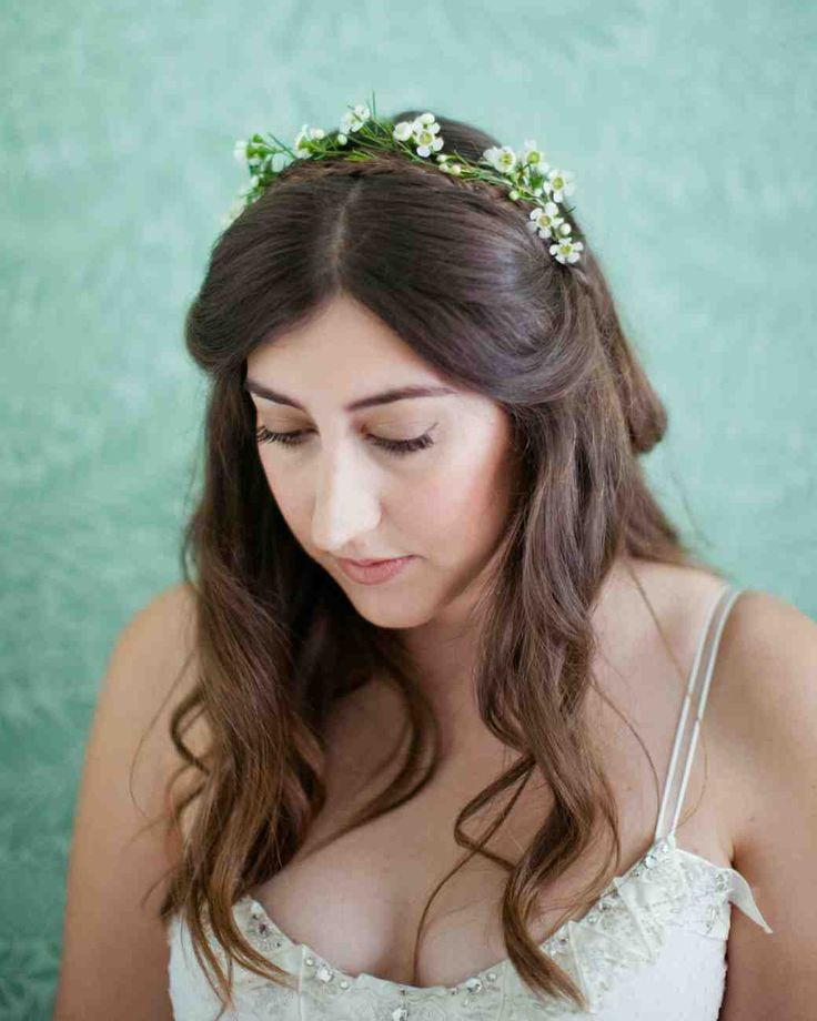Add a simple flower crown to make your wedding day hairstyle standout even more.