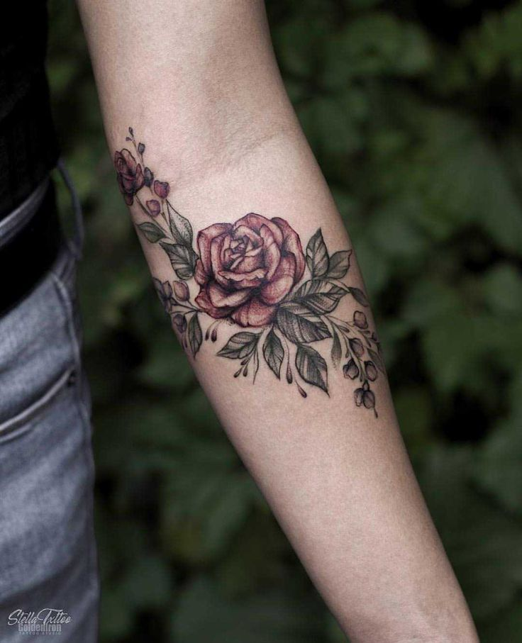 Floral piece on the left forearm by Stella
