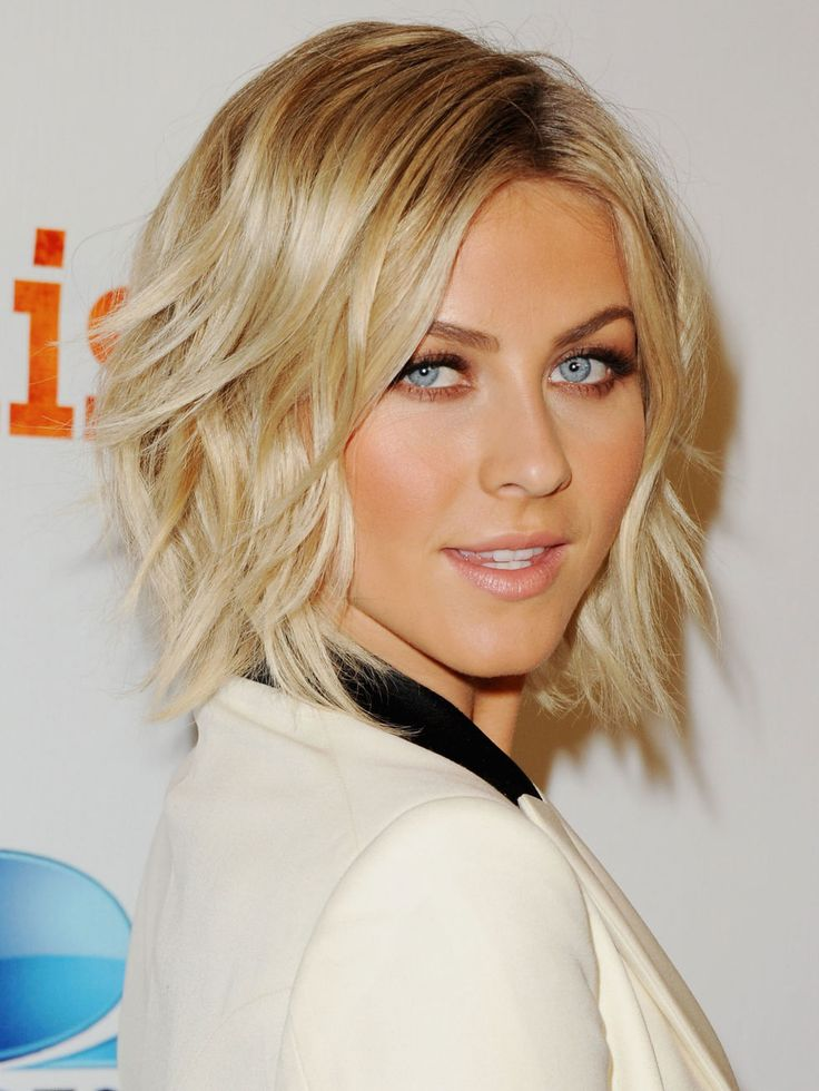 """Julianne rocks an undone bedhead look with a rounded shag. """"The shape of your hair will change depending on the cut,"""" explains Sims. If you want a full, rounded look like Julianne's, ask for lots of layers. If you wear your hair straight, request fewer."""