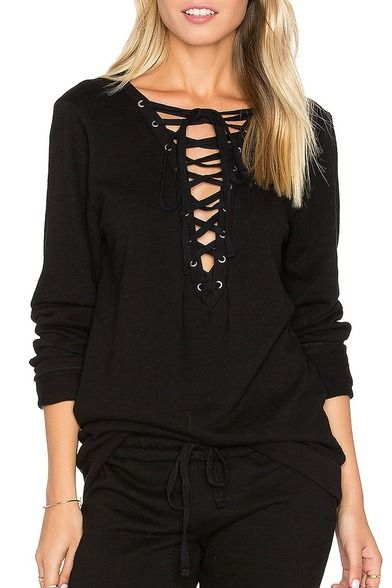 Dominic Long Sleeve Lace Up Top is 100% Cotton with front tie lace up closure. Ribbed trim enhances and 100% cotton assures comfort. The designers behind Michael Lauren take their comfortable pieces to a new level. Expect a range of lounge worthy basics for the woman who likes to relax in style. Dress it up or wear it casual. Find this and the latest Michael Lauren/Lauren Moshi at LulaMae Boutique in Jacksonville Beach, FL. www.lulamaestye.com  Call to order 904-372-7458.