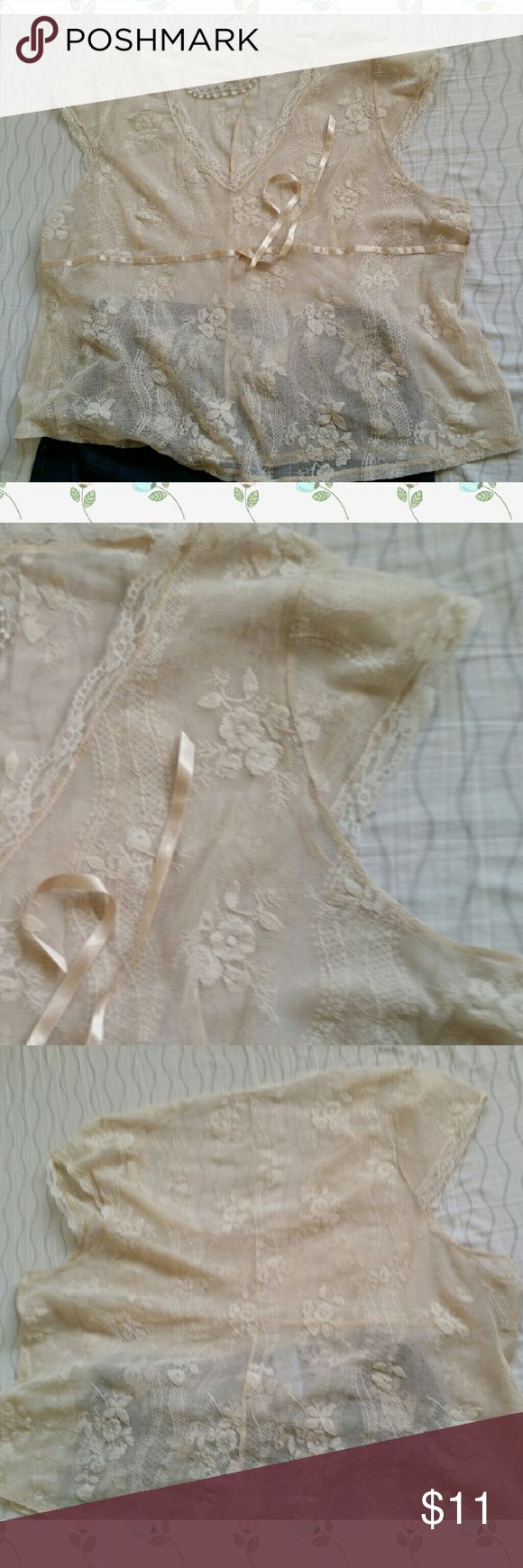 Vintage Cream Lace Top Vintage Cream Lace Top 2X Some lace is worn, but in great vintage shape no tags for brand or size but can fit a 2X with a nice flow. Has lace tie in front, does not pull fabric in sinched when tied.  Purchased at vintage store. Will need an undershirt to wear as there is no lining.  See my closet to bundle and save! Tops Blouses
