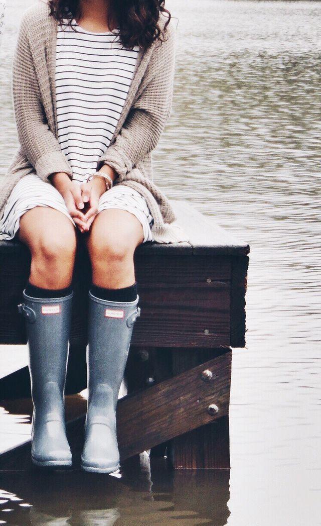 Beige cardigan, stripe dress, & rain boots.