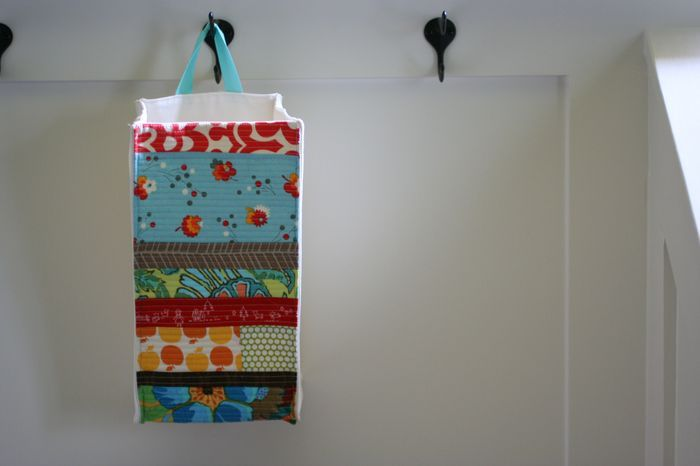 Great idea for storing plastic bags (has a slot in bottom to pull bags through)