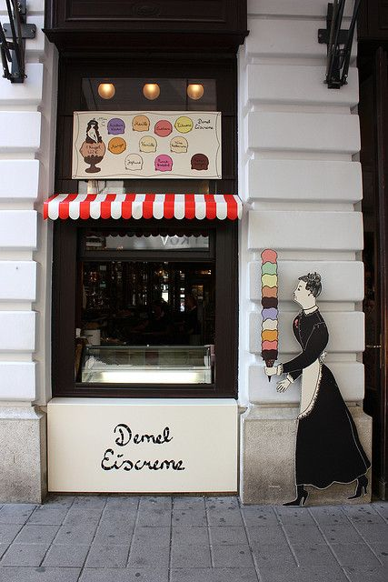 I love this skinny shop front. The dark paint is a great contrast to the surrounds while the display board and awning provide points of interests for potential customers.