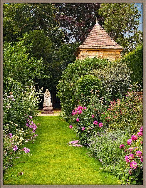 The gardens of Athelhampton House in Dorset, England - Athelhampton is one of the finest 15th century manor houses and is surrounded by one of the great architectural gardens of England.:
