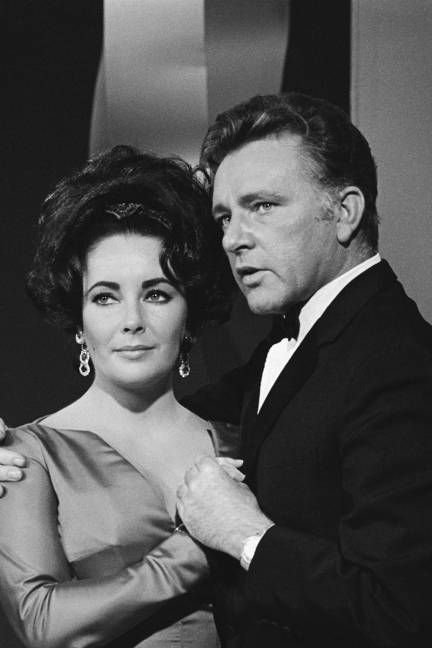 Elizabeth Taylor and Richard Burton, I love how he is holding her in this picture