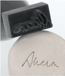 Signature Stamp - Jet Stamps. Could a person do this out of hot glue? Hmmm...