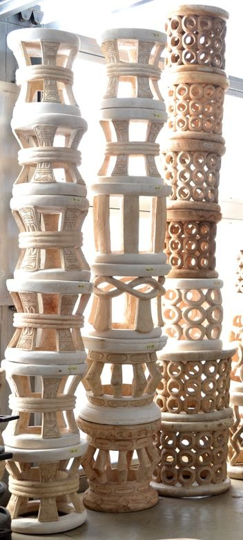 Intricately carved stools from Cameroon. Each stool is carved by hand from a solid piece of wood
