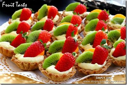 EASY FRUIT TART: (makes 14-16) 1 pkg Pillsbury pie crust,  1 pkg Jello Instant vanilla pudding,  Milk,  1 small can Mandarin oranges,  fresh strawberries,  Kiwi,  baking spray