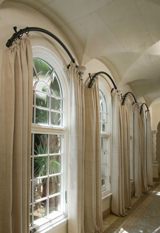 arched window treatment hardware - not sure how the rings are staying in place....I would assume there is a pin/nub holding each ring in place