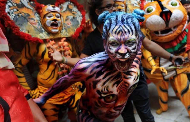 <p>Indian+dancers+paint+their+body+like+tigers+as+they+perform+a+Tiger+dance+during+the+International+day+of+the+Tiger+in+Calcutta,+India,+July+29,+2015.+Students+of+Calcutta+are+taking+part+in+an+awareness+campaign+aiming+to+draw+attention+to+the+threats+that+tigers+face+due+to+habitat+loss+…</p>