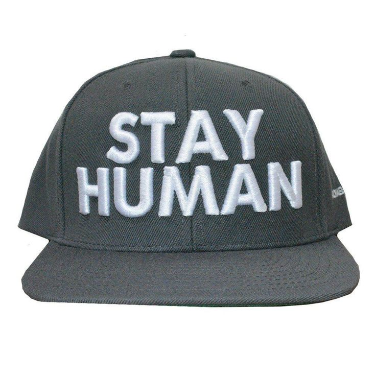 Adjustable, greybaseball hat embroidered with STAY HUMANon the front. This is a classic Snapback hat with stretch for added comfort and perfect fit.