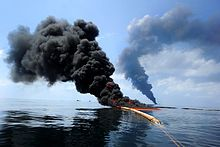 Deepwater Horizon oil spill - Dark clouds of smoke and fire emerge as oil burns during a controlled fire in the Gulf of Mexico, 6 May 2010