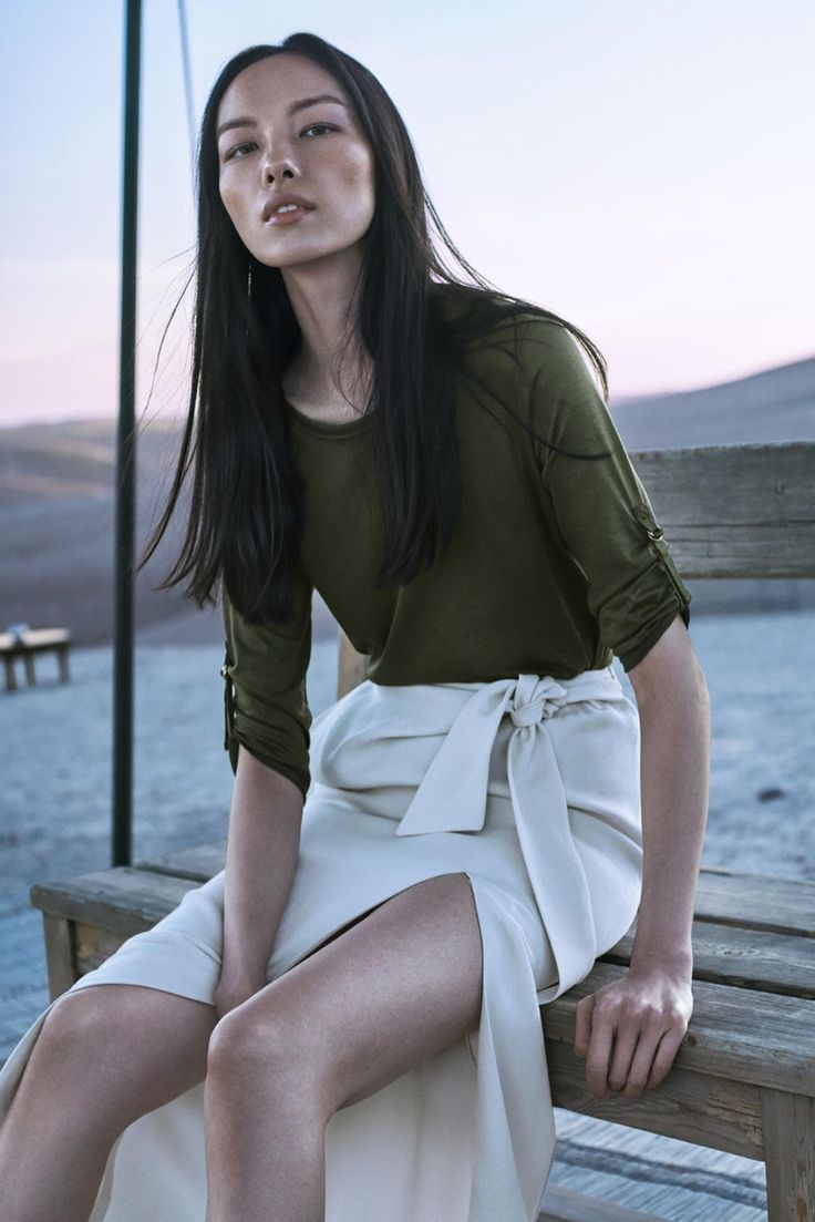 Fei Fei Sun wears khaki green shirt and maxi skirt with slit from Massimo Dutti