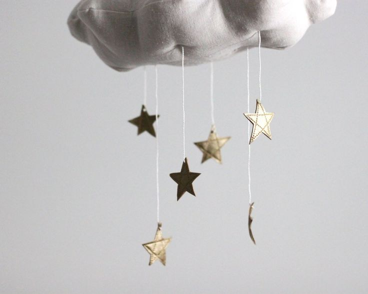As seen on the cover of Today's Parent Magazine, this handmade cloud mobile is scattered with golden stars to twinkle and delight your little dreamer. The perfe