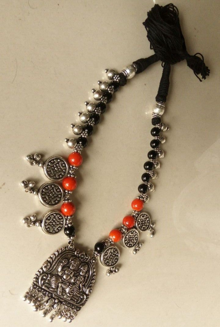 Pretty Thread Necklace Set With Oxidised German Silver Temple Pendant With Earring