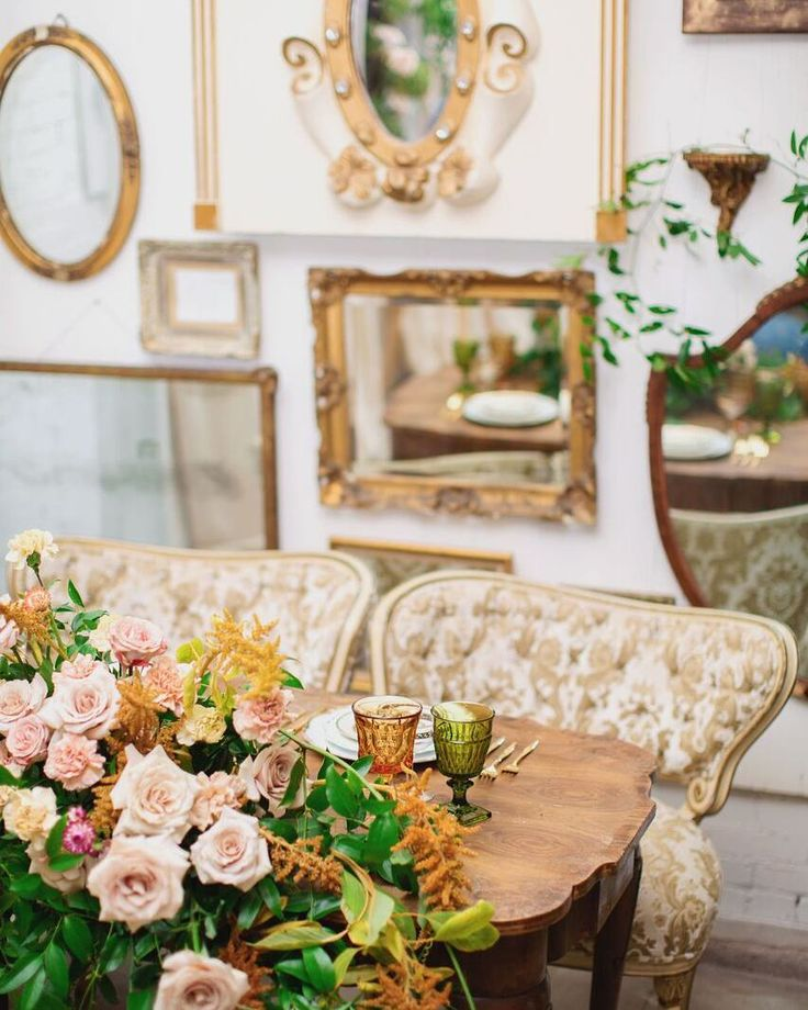 Our gold Dortches boudoir chairs making a statement at this sweetheart table with a unique eclectic mirror wall backdrop!    Venue & Vintage Furniture: @sweetsalvagerentals   Photography: @splitprismphotography   Floral Design: @penelopepotsfloraldesign   Stationery: @atelierazure   Tableware: @cherrishedrentals   Bridal Gown: @rmine   Ring: @scoutmandolin   Hair & Makeup: @face_it_sugar   Model: @sydneyhammofficial
