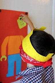 Lego birthday party game - pin the lego head on the lego man. You could have a different head for each kid...