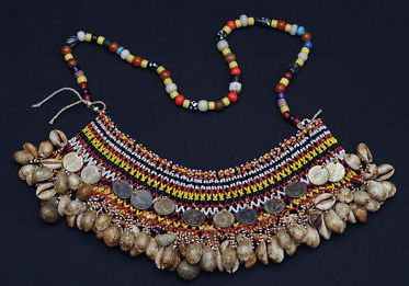 Philippines | A woman's neckpiece ~ 'Karaweweng' ~ from the Gaddang people, Isabela, North Luzon.  The beaded centerpiece worn towards the back.  | Multi-colored beads, cowry shells, and 1944-45 twenty centavo coins. | ca. 1940 | Sold