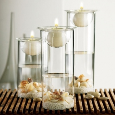 Tablescape sand with shells on bottom of vase water and candles  Cool Stuff in 2019  Candles