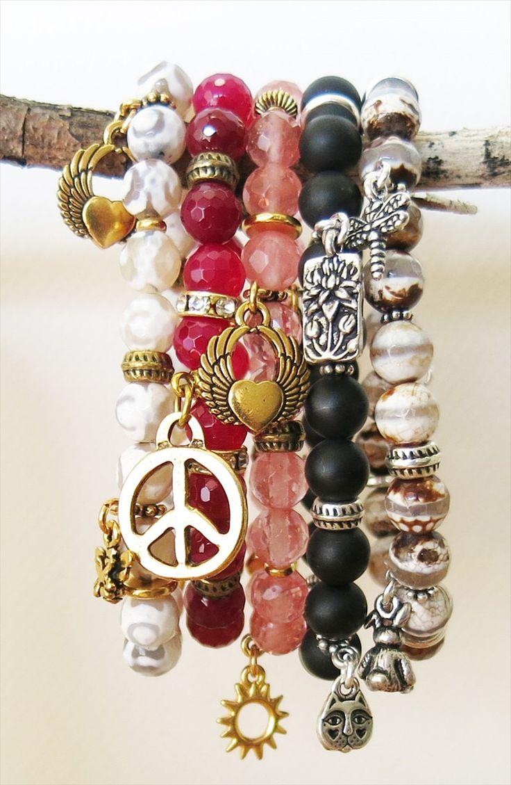 Stretch bracelet with silver charms and beads, black onyx gemstone, boho, stacking, bohemian chic from MiaBellaJeweleria by MiaBellaJeweleria on Etsy