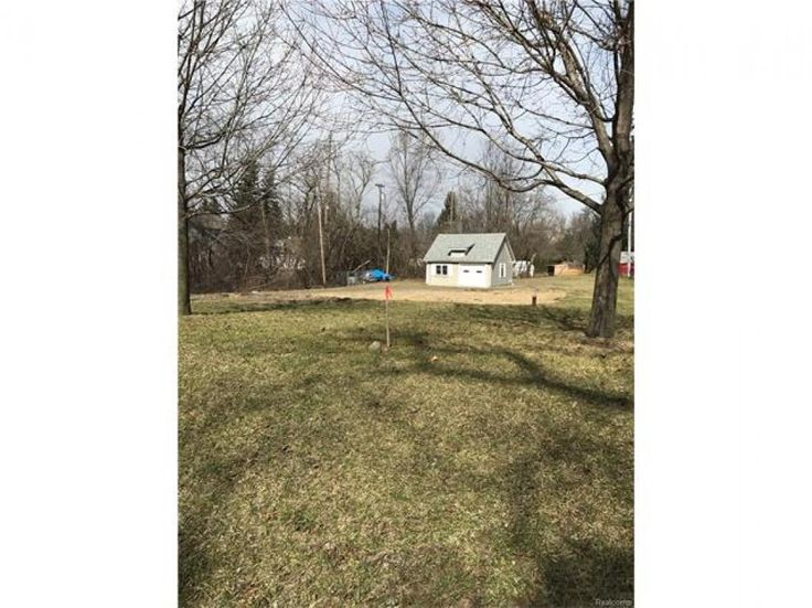 Perfect opportunity to build your dream home on this half acre wooded lot. Quiet surroundings. There is an existing driveway, well and 2-car garage/pole barn. Current owner has professionally drawn plot plan and architectural plans for a 1,500+ sq ft, 3 bedroom, 2-1/2 bath ranch with full daylight basement and 2 car attached garage that he is willing to give to new buyer. The 1920s home that was previously on the lot was taken down in 2016 due to age of structure. City sewer is at the street…