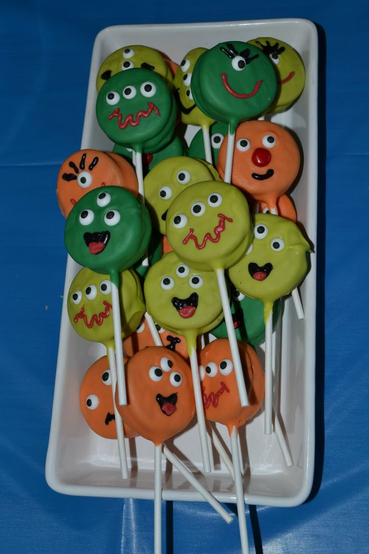 Halloween treat - stick a lollipop stick into the cream between a double-stuffed oreo, then coat with melted candy / white chocolate and decorate as monsters.