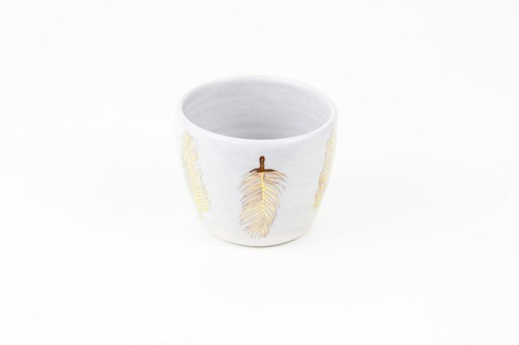 Keep your tiny trinkets safe in this handmade tumbler featuring gold feathers. www.mooreaseal.com
