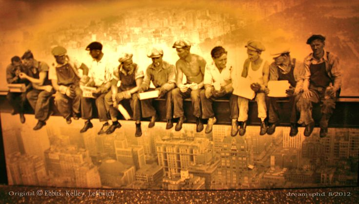 Famous photo, now a mural, of Steel Workers building Rockefeller Plaza in 1932.  While they are staged to appear casually having lunch on a single steel beam at the height they are actually working with no safety supports.  That photo is now a mural on the observation deck which I photographed in 2012.