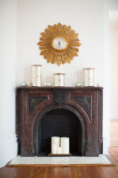 Rustic fireplace decor: http://www.stylemepretty.com/living/2014/10/14/behind-the-scenes-gather-together/ | Photography: Katherine Miller Jones -http://www.katherinemilesjones.com/: