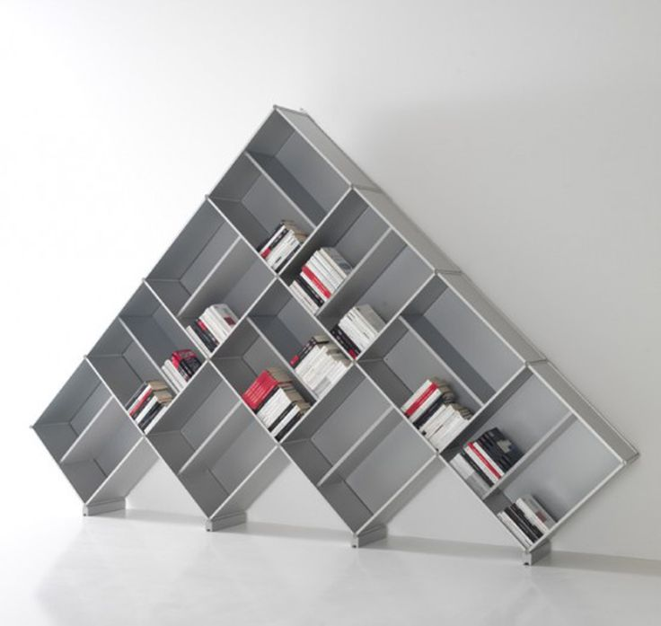 looking for unusual ways to display my books - this concept makes sense - think about when you are perusing the book selection...do you tilt your head to read the spines?  Leaning them on the diagonal would eliminate that - SMART!