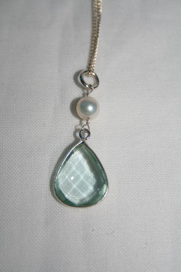 Zilveren ketting met hanger van Aquamarijn en zoetwater pareltje