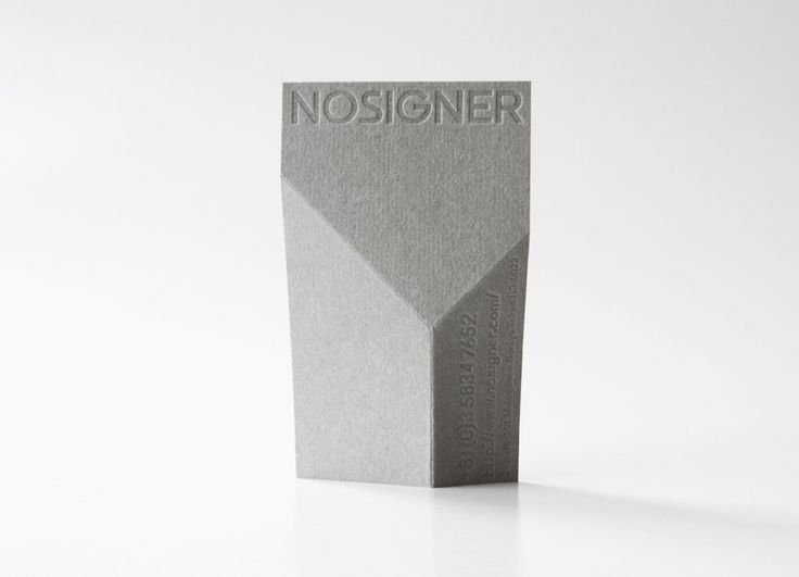 Nosigner business card with fold detail.