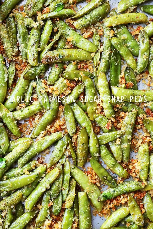 Garlic Parmesan Sugar Snap Peas - Healthy, delicious and quick to make roasted sugar snap peas tossed in a crunchy and flavorful parmesan cheese mixture.