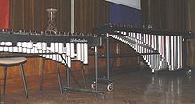 """The xylophone (from the Greek words ξύλον—xylon, """"wood"""" + φωνή—phōnē, """"sound, voice"""", meaning """"wooden sound"""") is a musical instrument in the percussion family that consists of wooden bars struck by mallets."""