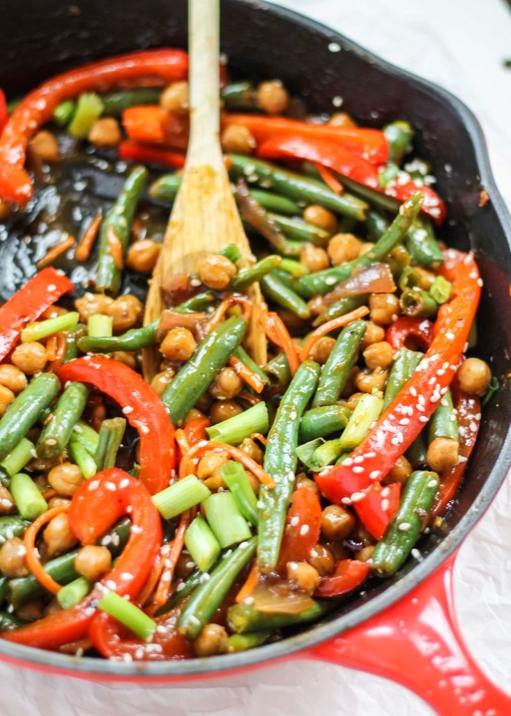 Sesame-Ginger Orange Chickpea Stir-Fry loaded with veggies. This is a healthier, vegetarian version of your favorite take-out!