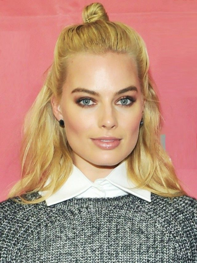 Margot Robbie with a hun hairstyle.
