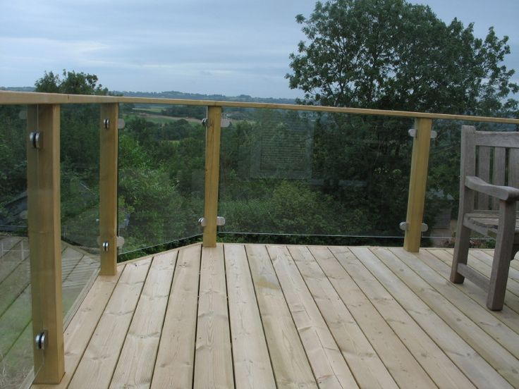Glass panel railings for decks inside out decking for Garden decking banister