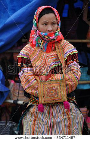 SAPA, VIETNAM - FEBRUARY 22, 2013: Hmong women at Bac Ha market in Northern Vietnam.  Bac Ha is hilltribe market where people come to trade for goods in traditional costumes