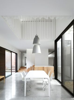A rectangular void is positioned above the ground-floor dining zone as a means of informal spatial definition.