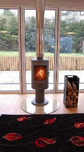 Check out this chic, cylindrical black free standing wood-burning stove which makes a fabulous centre piece in your living room.