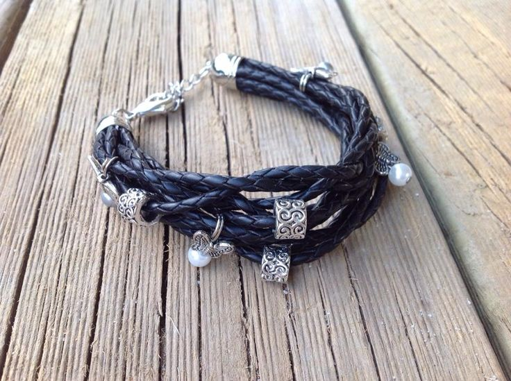 Black leather bracelet with butterfly charms.
