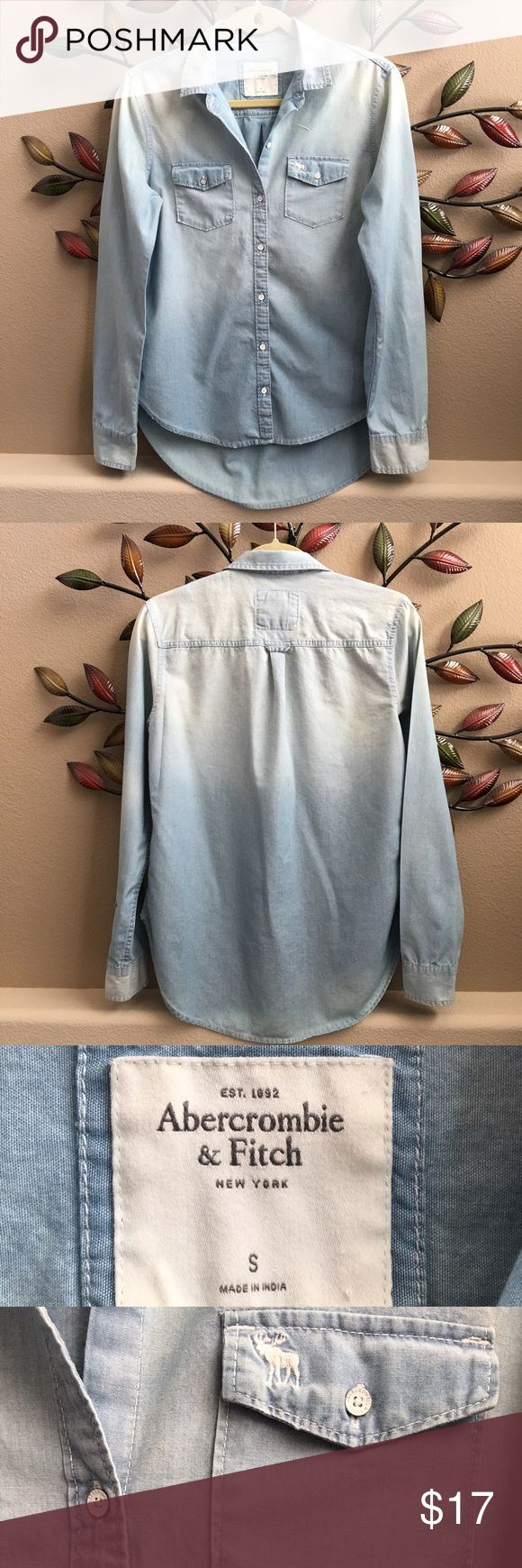 Abercrombie and Fitch Shirt Distressed chambray shirt. Great condition, the distressed look on it is the way it was purchased. Adorable with leggings or just about anything. Great versatile peace. Abercrombie & Fitch Tops Button Down Shirts
